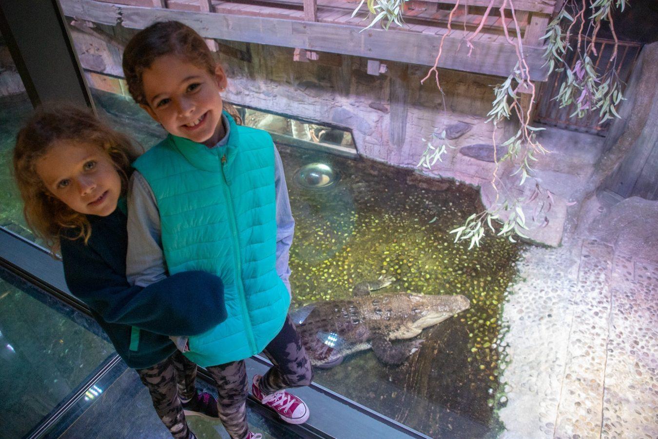 Standing over the croc in the Aquarium