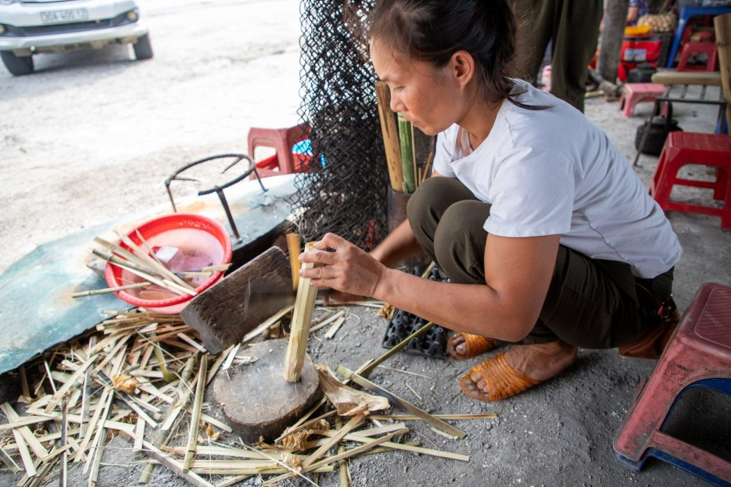 Cutting the bamboo away from what was soon to be our sticky rice snack