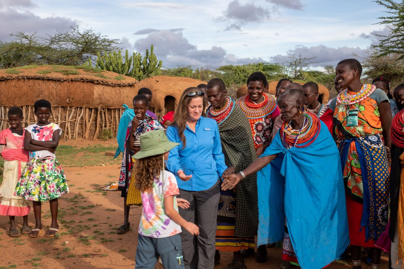 the ladies welcoming the girls to their village
