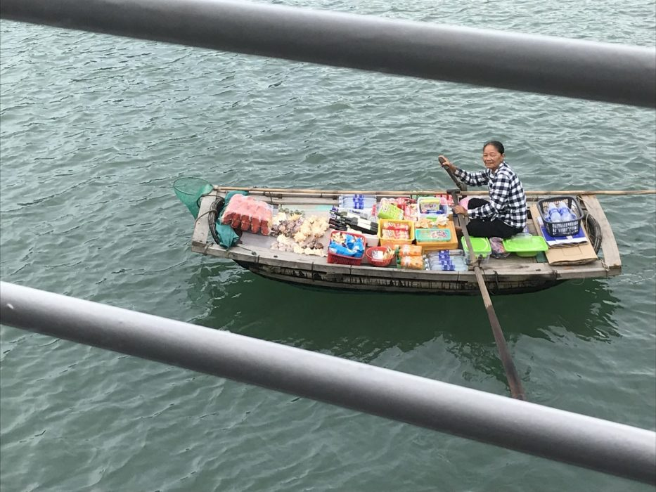 A floating market boat, trying to sell to the passengers on board